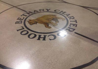 Polished concrete with custom logo stencil